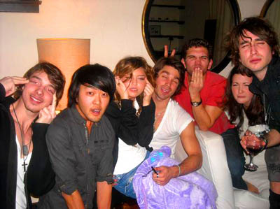 Miley Cyrus and friends make Asian squinty eyes